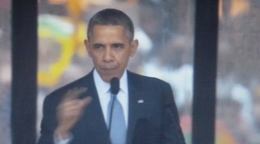 Spooky spin: Obama telling a freedom-themed fable in Soweto.