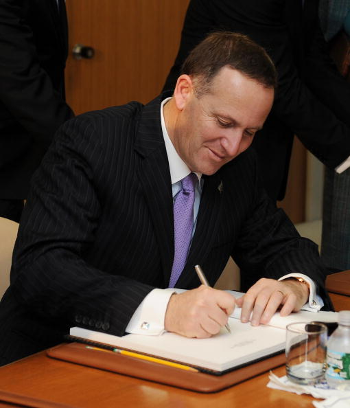 Winning by Any Means Necessary: The 'Smiling Assassin' hand writes the official draft into the Cabinet Diary.