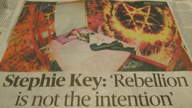 Bedroom in Hell: Cherry Lazar posed with an occult firey pentacle symbol.