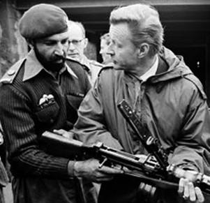 "U.S. Foreign Policy Advice in the Kyber Pace: Brzezinski manhandles a machine gun at a Pakistan Army outpost after having armed the Mujhaddin ""hotheads"" (February 3, 1980)."