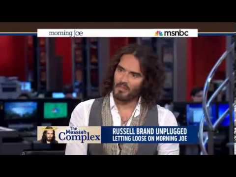 MOCKING THE MEDIA COMPLEX: Comedian Russell Brand feigned reading the news as a way to highlight the trivialization major issues by the news media.