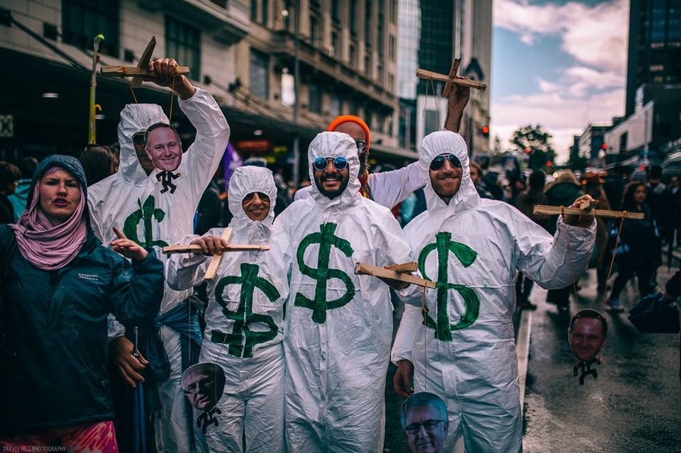 TPPA Street Theatre: Exposing the strings behind cheesy political puppets. [Photo: Travis Hill]