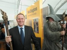 Blurring the Boundaries: A  brooding Gandalf watches on as former City of London and Wall Street Banker John Key grins from ear to ear in an image that escapulates the banking industry's make-believe credit conjuring tricks.